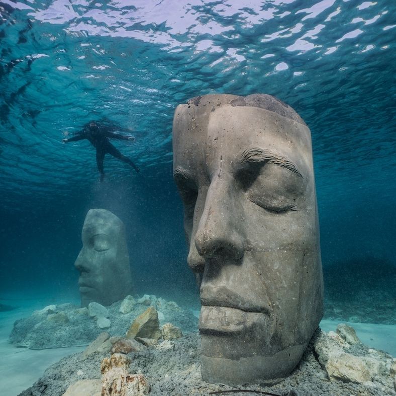 Underwater sculptures with a diver nearby.