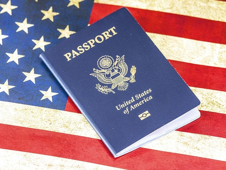 US passport on top of American flag