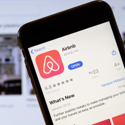 Using the Airbnb app on a mobile phone.
