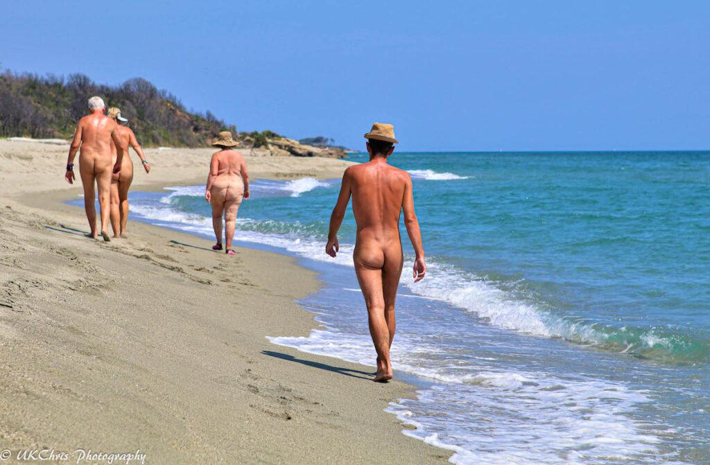 Vacationers enjoying a nude beach.