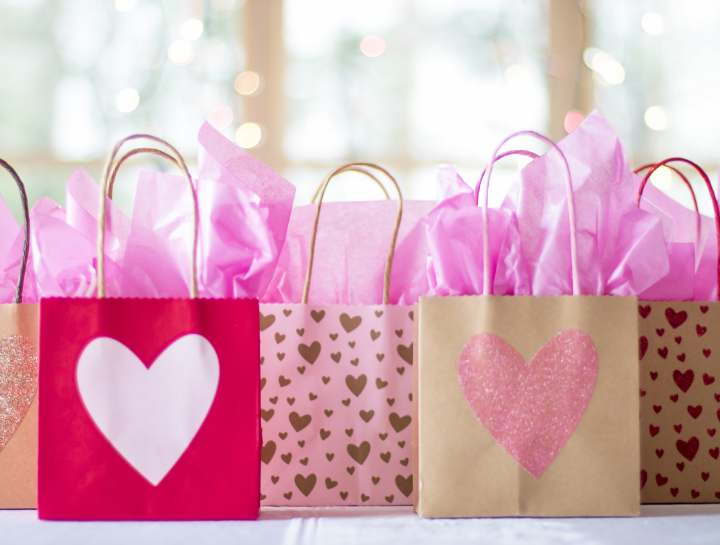 Valentine's Day gift bags with hearts and pink tissue paper