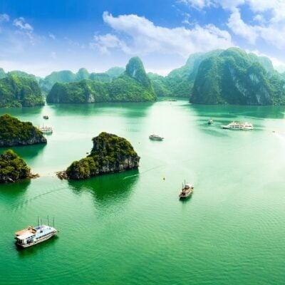 various ships in green ocean water
