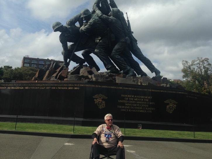 Veteran in front of Marine Corps War Memorial.