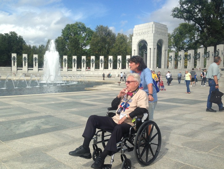 Veteran in wheelchair at WWII Monument.