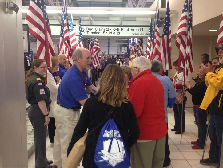 Veterans being welcomed home at the airport.