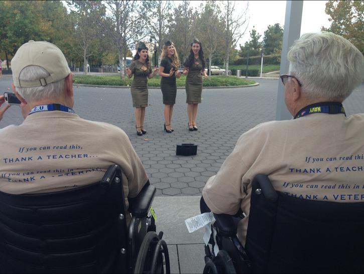 Veterans watch singers at Air Force Memorial.