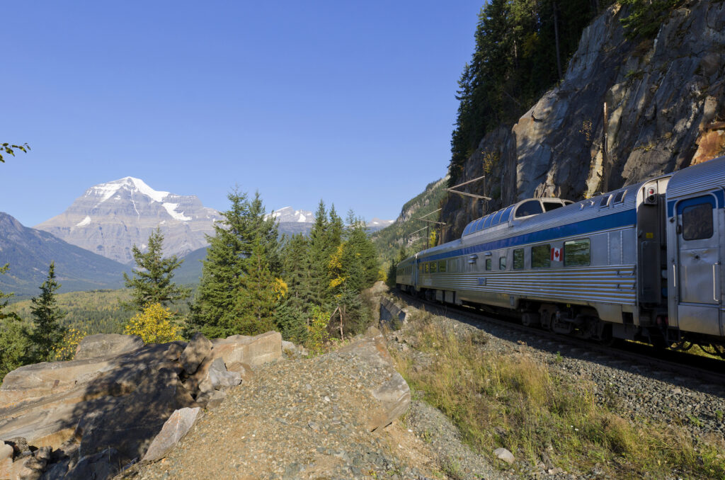 VIA Rail's The Canadian traveling through mountains.