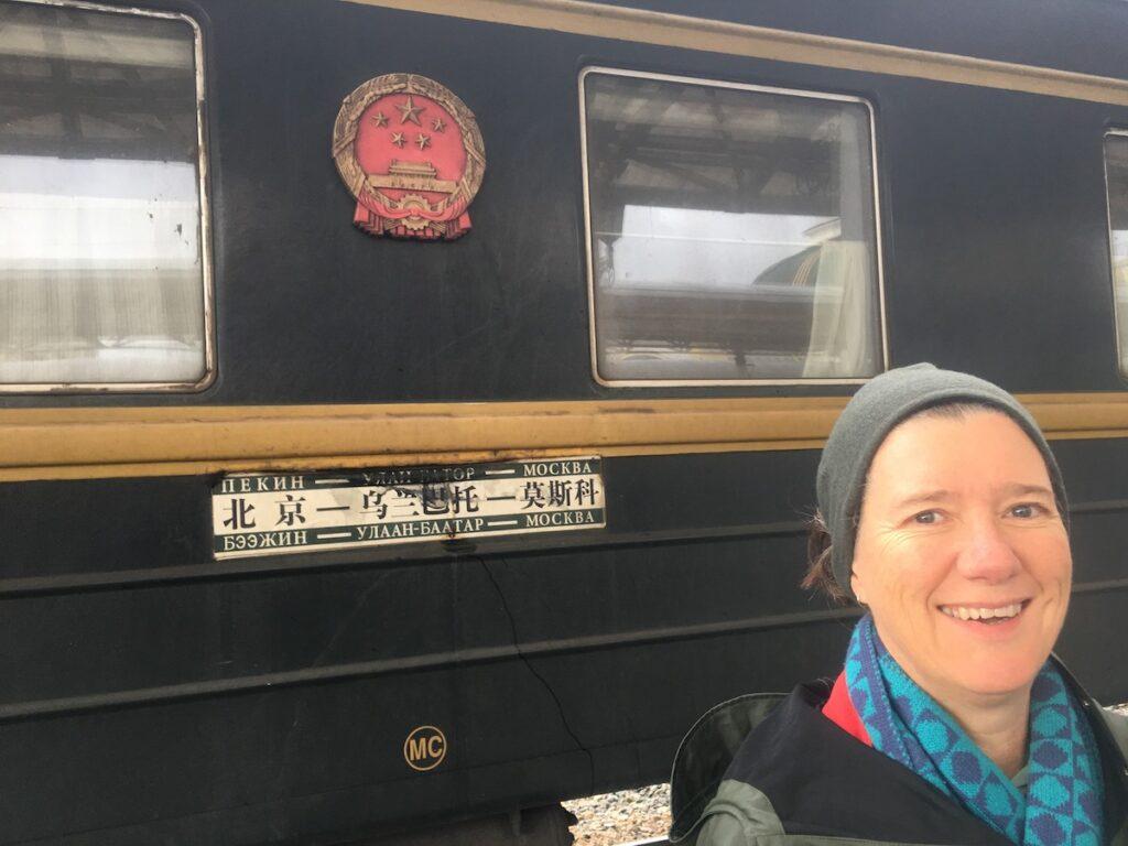 Victoria Osborne outside a train in China.