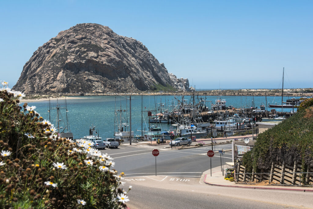 Views of Morro Rock from the harbor of Morro Bay.