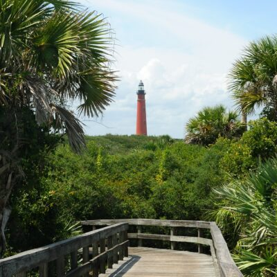 Views of Ponce Lighthouse from a boardwalk trail in New Smyrna Beach, Florida.