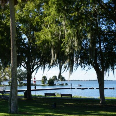 Views of the Mount Dora Lighthouse and Lake Dora in Florida.