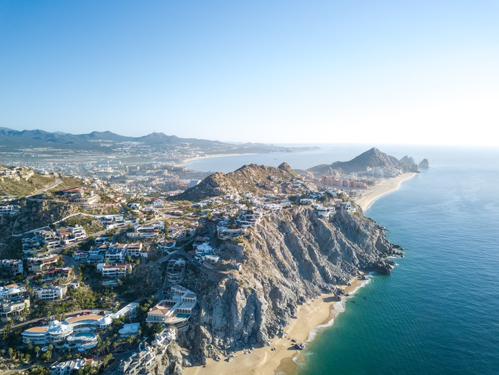 Villas and resorts dot the cliffs along the shore of Cabo San Lucas.