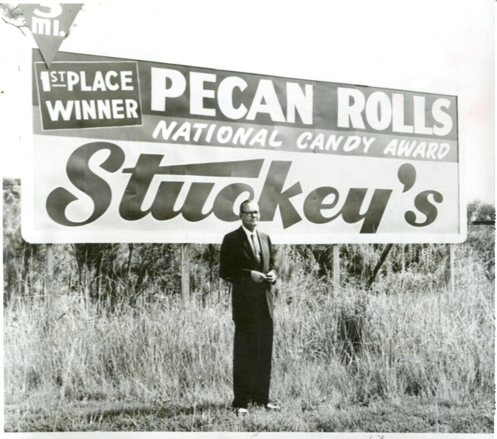 W.S. Stuckey, Sr., in front of one of Stuckey's early billboards.