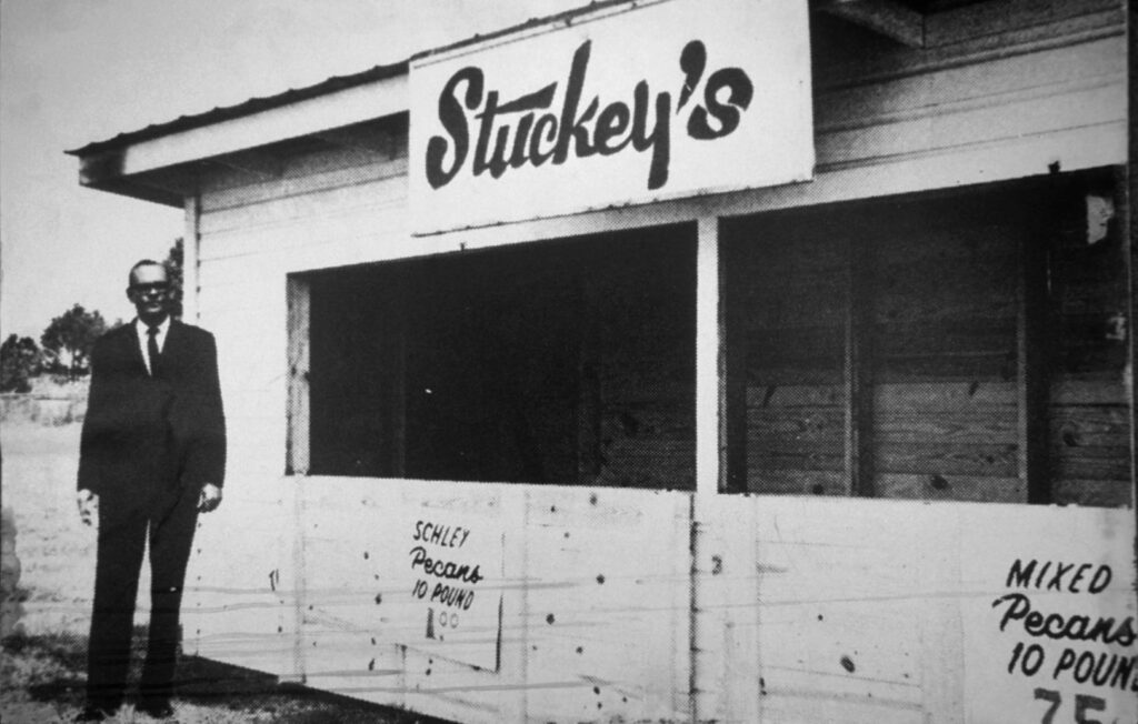 W.S. Stuckey, Sr. in front of a replica of the first Stuckey's.