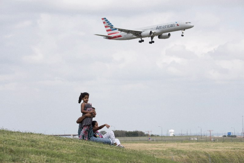 Watching airplanes from Founders Plaza in Dallas, Texas.