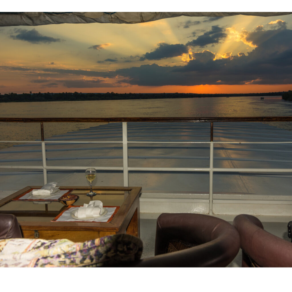 Watching the sunset on Chobe river from the Zambezi Queen.