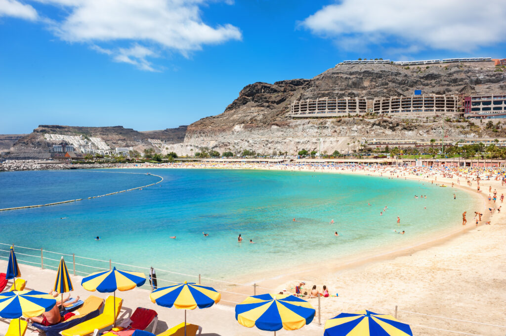 white sand beach with umbrellas and chairs on Gran Canaria