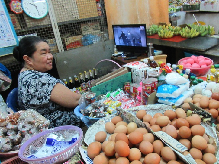 Woman in the flower market selling eggs.