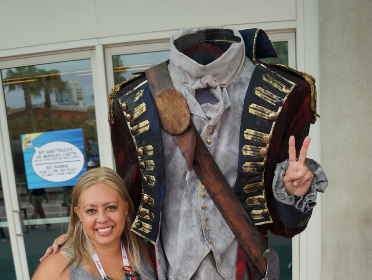 Woman posing for picture with headless horeseman, Sleepy Hollow