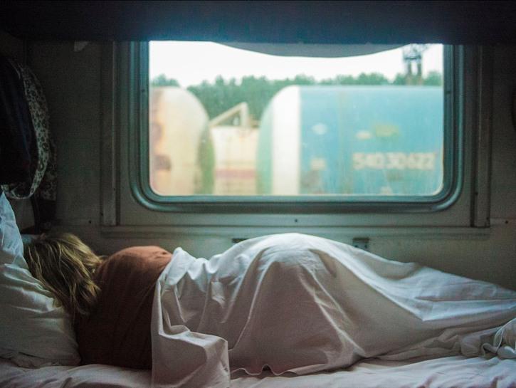 Woman sleeping on train.