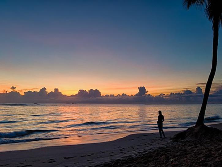 Woman standing on beach, Bávaro Beach, Punta Cana, Dominican Republic