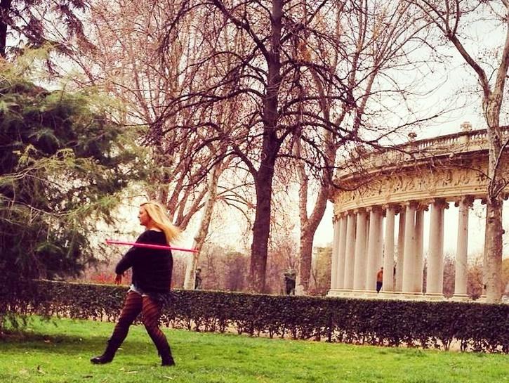 Woman walking through Retiro Park, Madrid, Spain
