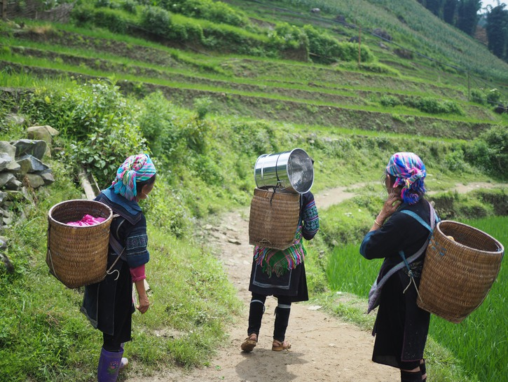 Women carrying baskets on their backs