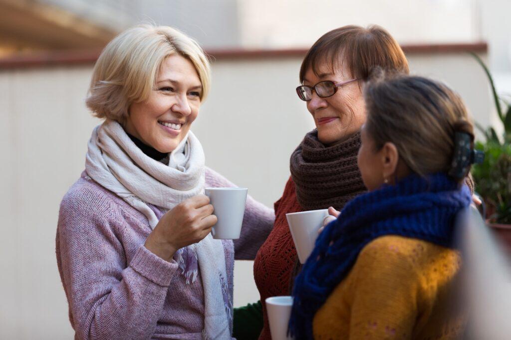 Women enjoying coffee together.