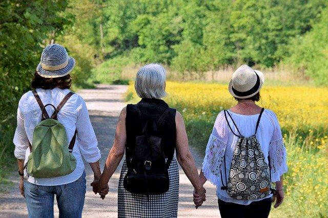 women holding hands hiking