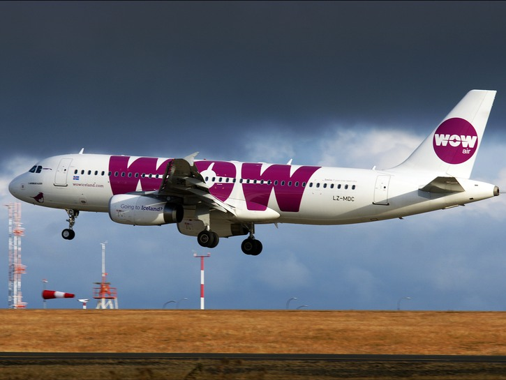 WOW Air flight just after take off, dark clouds in the distance