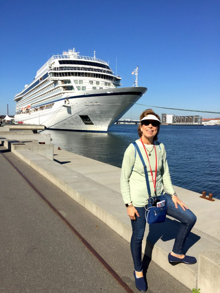 Writer Judy standing in front of a Viking cruise ship