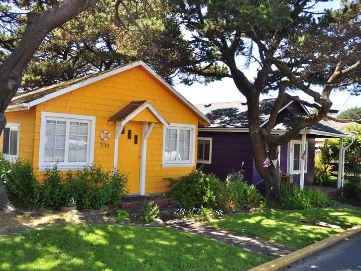 Yello and brown bungalow houses on suburban street