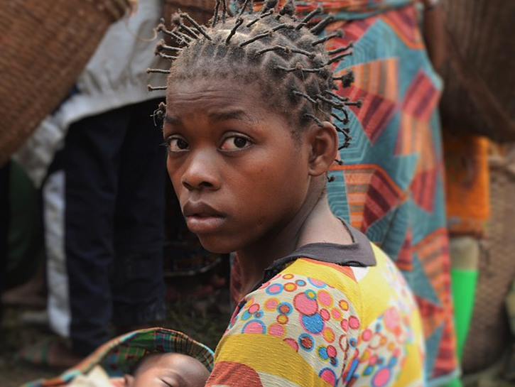 Young Congolese woman holding baby