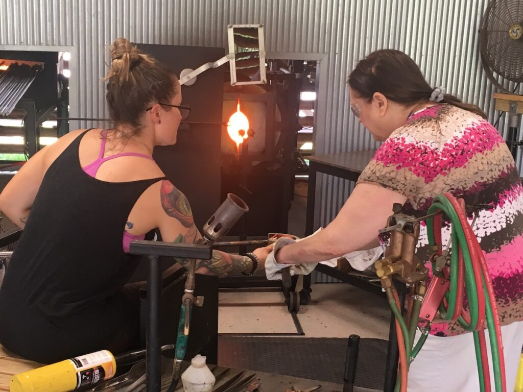 The writer at a glassblowing event.
