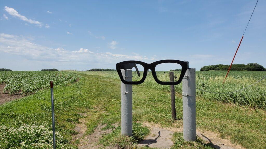 Buddy Holly glasses trail marker, Clear Lake, Iowa.