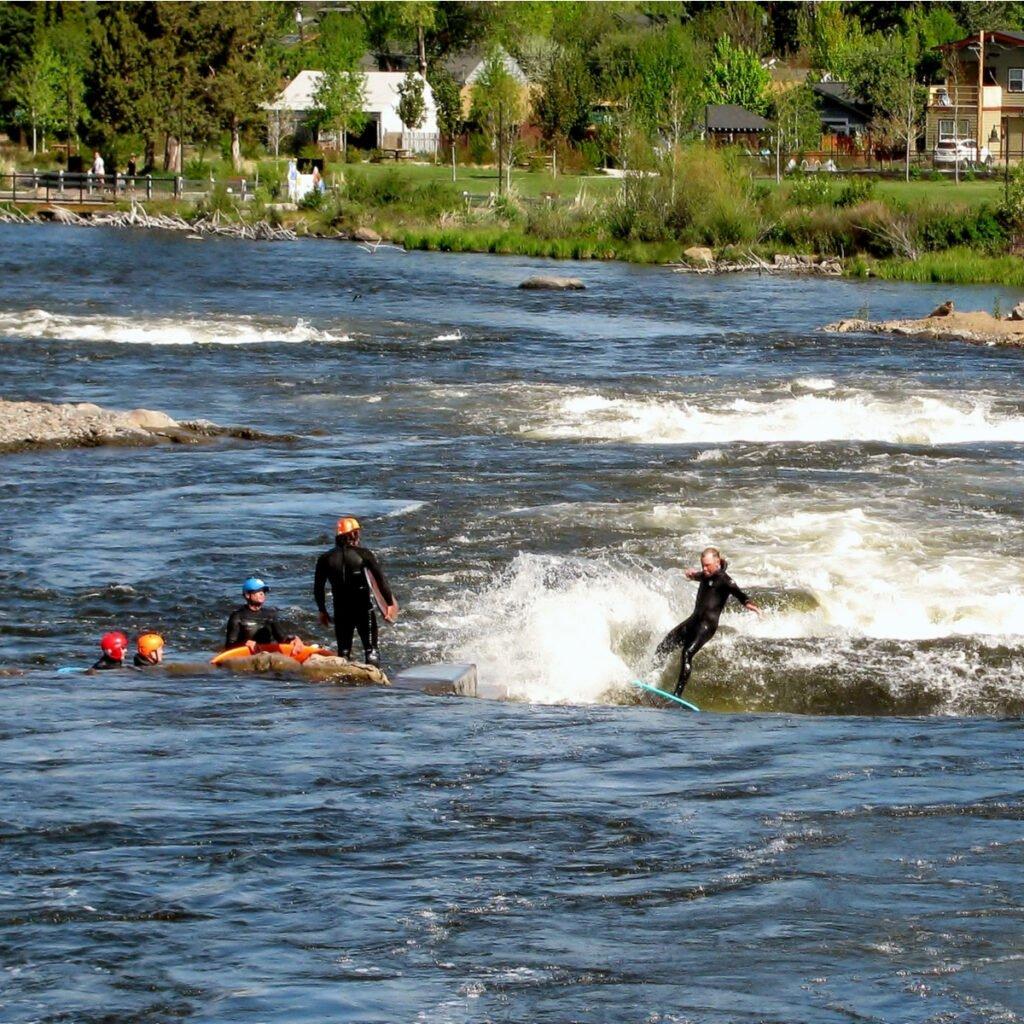Surfing in Deschutes River.