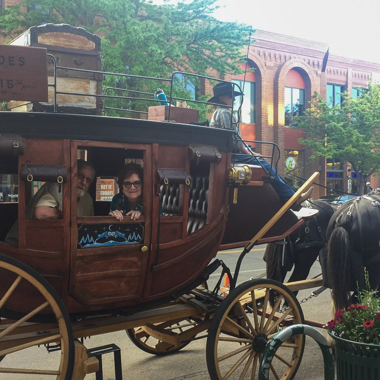 The writer on a stagecoach.