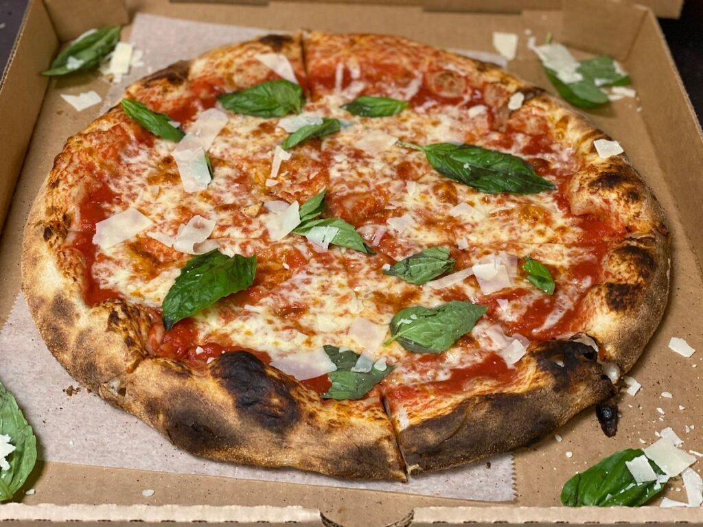 Tomato, cheese, and basil pizza