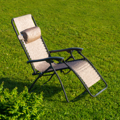 Lounge chair on green grass
