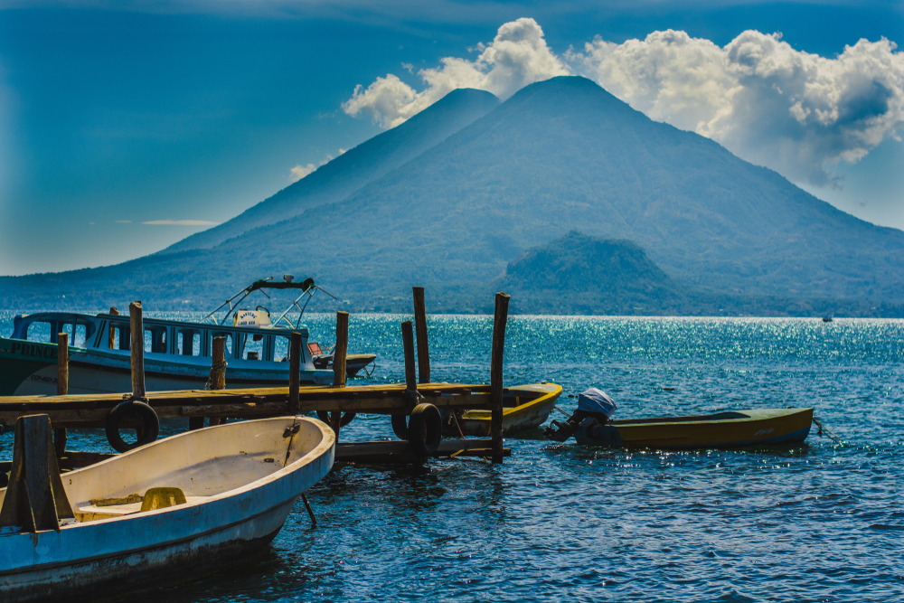 Lake Atitlán, Guatemala, with volcanoes in the background.