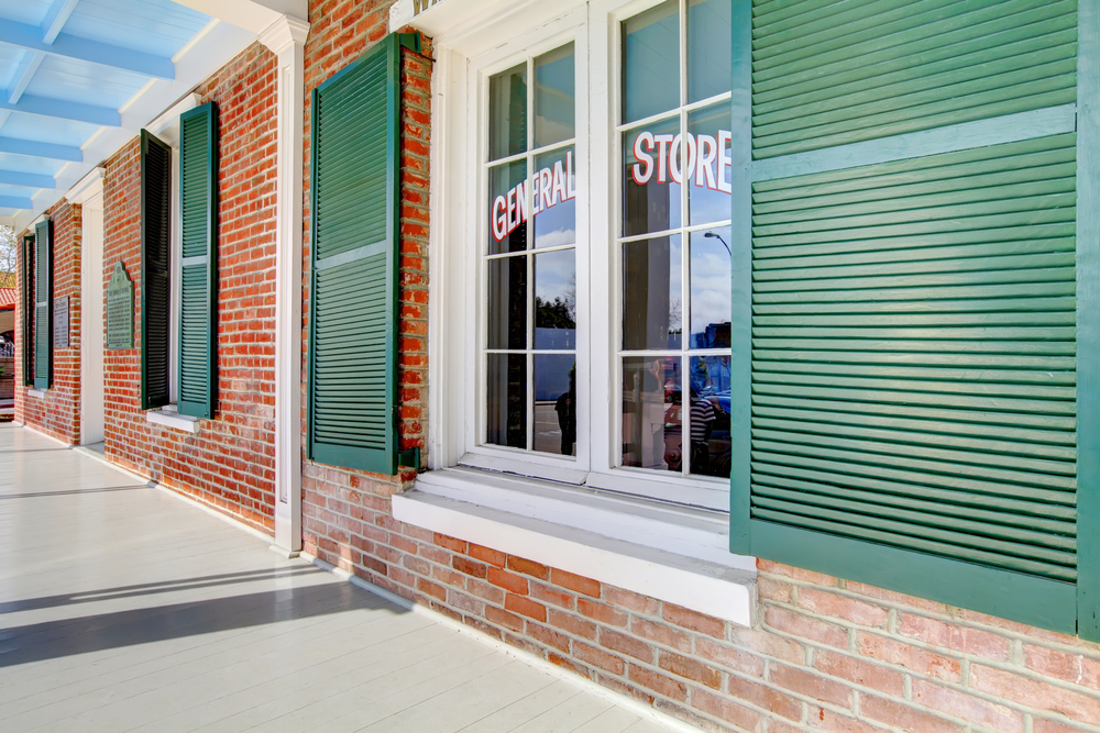 Whaley house museum porch in San Diego with exterior windows.