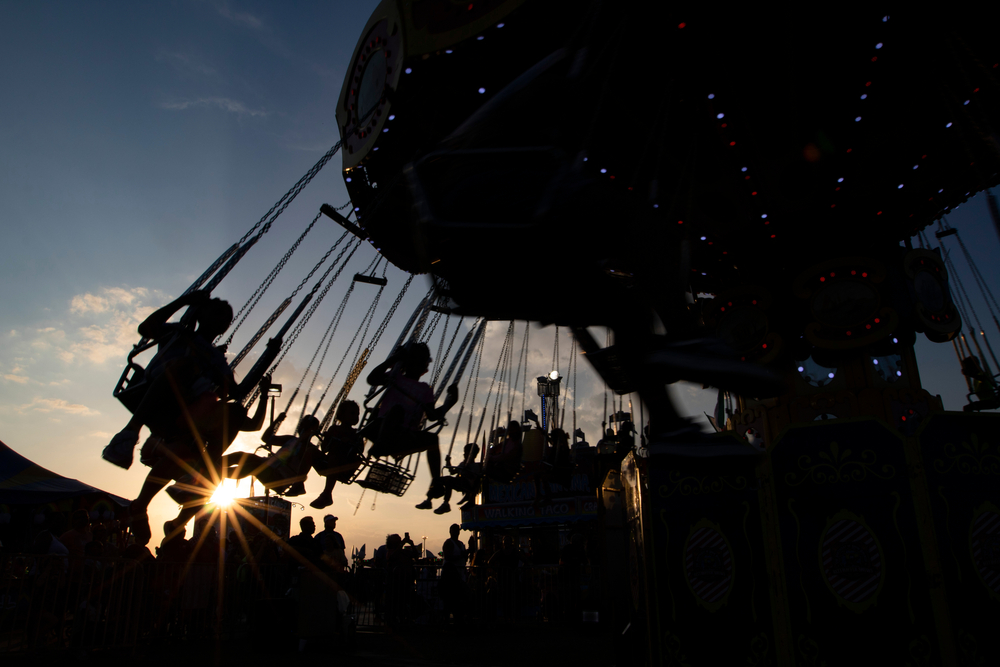 Children fly through the air in swings at the Georgia National Fair in Perry, Georgia.
