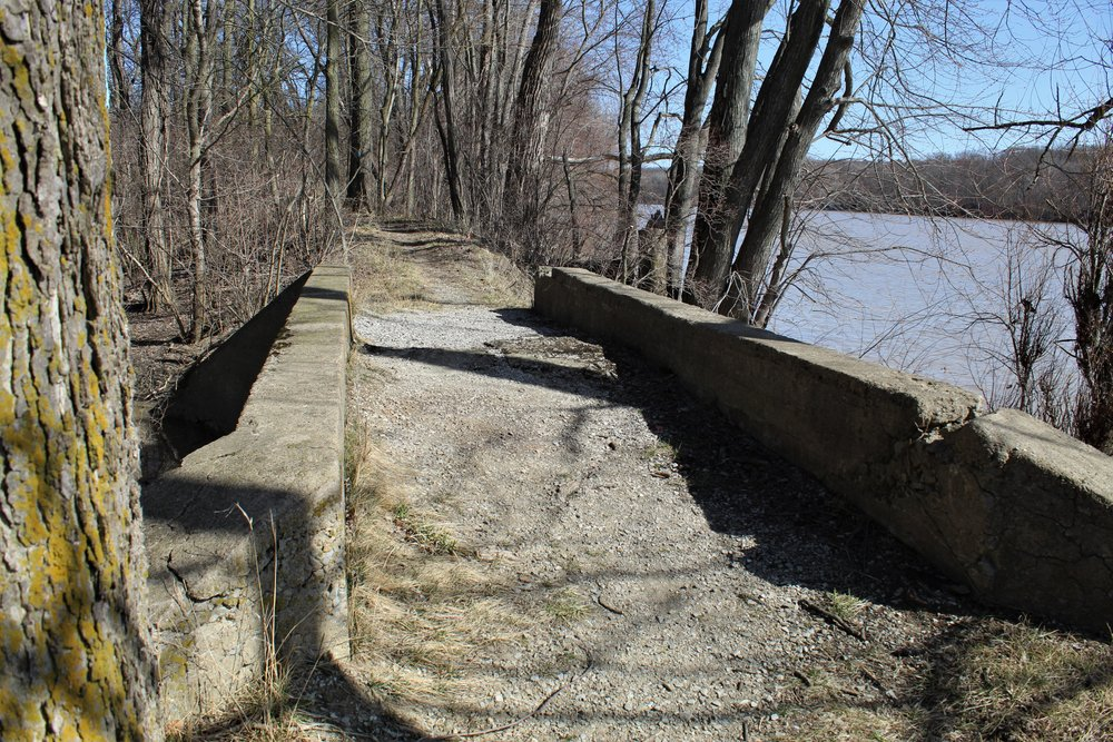 An old mule tow path crossing a small cement bridge on the Miami-Wabash-Erie canal. This bridge was near the entrance of the lock by Independence Dam, Defiance, Ohio.