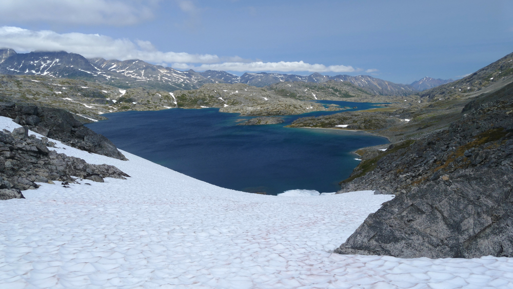 Famous Chilkoot Trail, Crater Lake alpine zone with snow, historic gold rush hiking route between Alaska and British Columbia, Canada