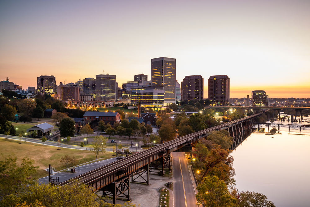 Downtown Richmond, Virginia, skyline and the James River at twilight.
