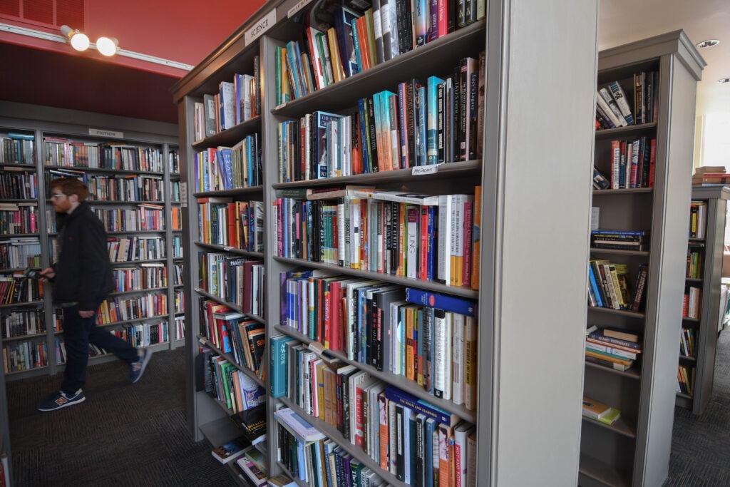 A customer browses aisles at Book and Bar Porthsmouth, N.H.