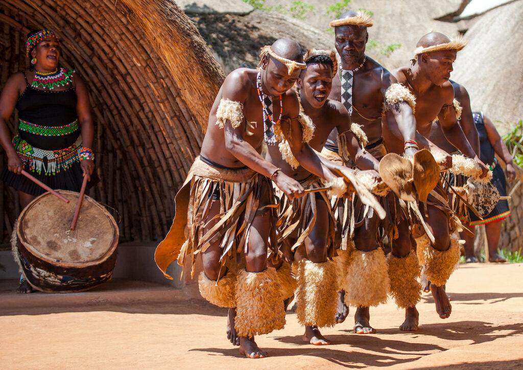 Zulu tribe members dancing.