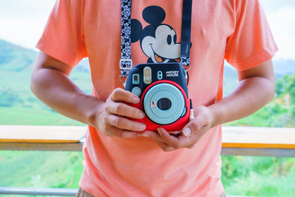A person with a Disney camera.