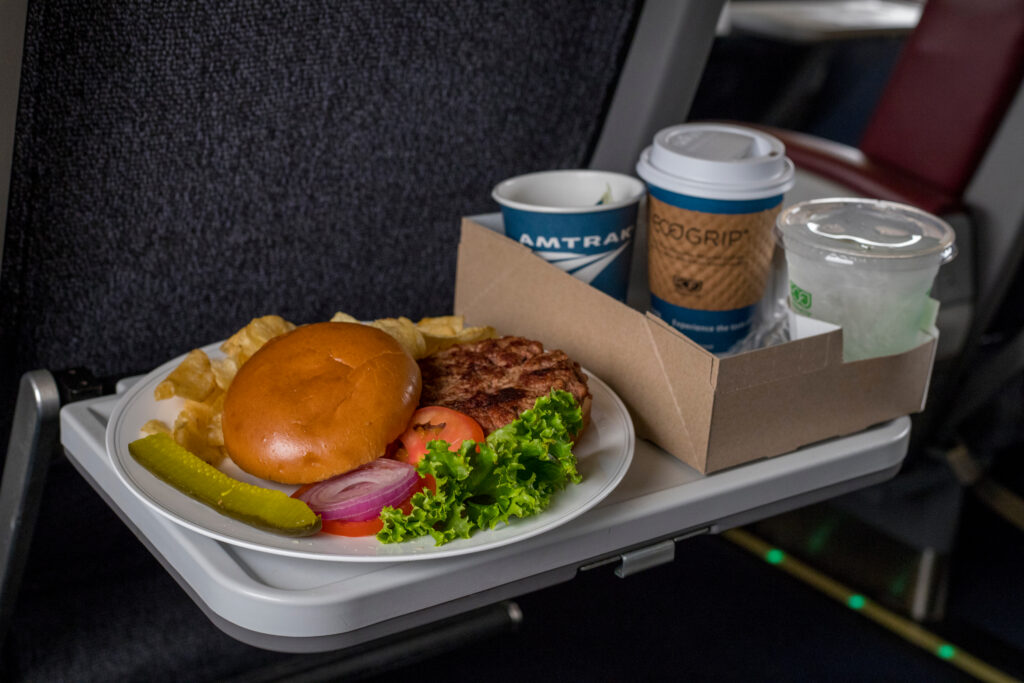 A burger meal with coffee served on Amtrak.