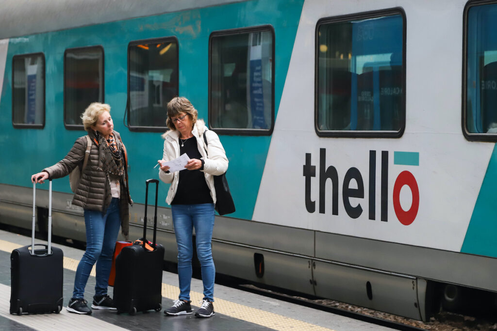 Two people near a Thello train.